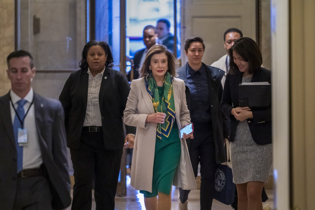 Speaker of the House Nancy Pelosi, D-Calif., arrives to meet with the Democratic Caucus at the Capitol in Washington, Tuesday, Jan. 14, 2020.  (AP Pho...