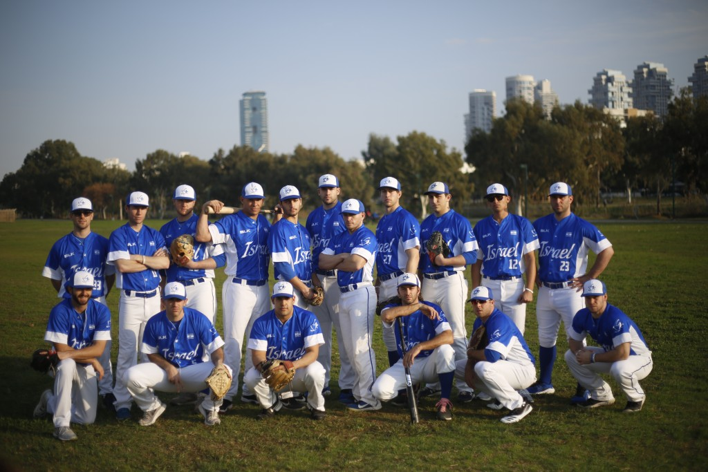 In this Tuesday, Jan. 14, 2020 photo, Israel's national baseball team poses for a group photo at a team practice in Tel Aviv, Israel. Team Israel's im...