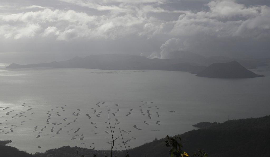Taal volcano continues to spew ash as seen from Tagaytay, Cavite province, southern Philippines on Wednesday Jan. 15, 2020. So far no one has been rep...