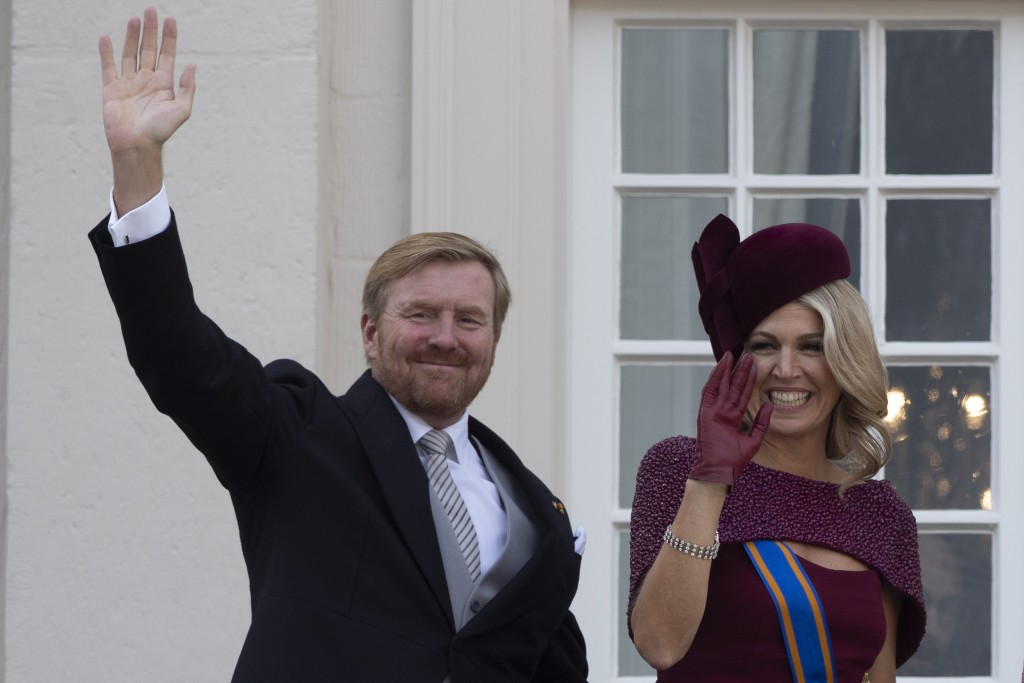 FILE - In this Tuesday, Sept. 17, 2019 file photo, Dutch King Willem-Alexander and Queen Maxima wave from the balcony of royal palace Noordeinde in Th...