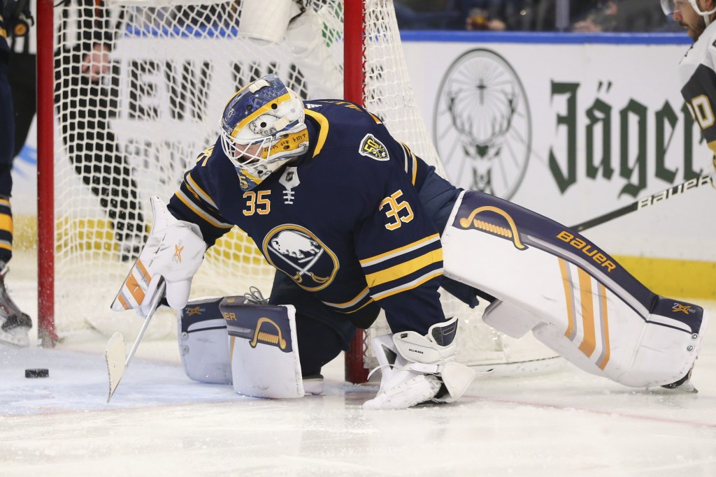 Buffalo Sabres goalie Linus Ullmark (35) watches the puck go in the net during the second period of an NHL hockey game against the Vegas Golden Knight...
