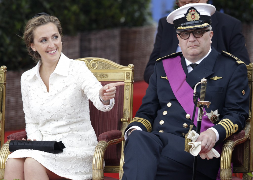 FILE - In this Monday, July 21, 2014 file photo, Belgium's Prince Laurent and his wife Claire watch a military parade on Belgian National Day, in fron...