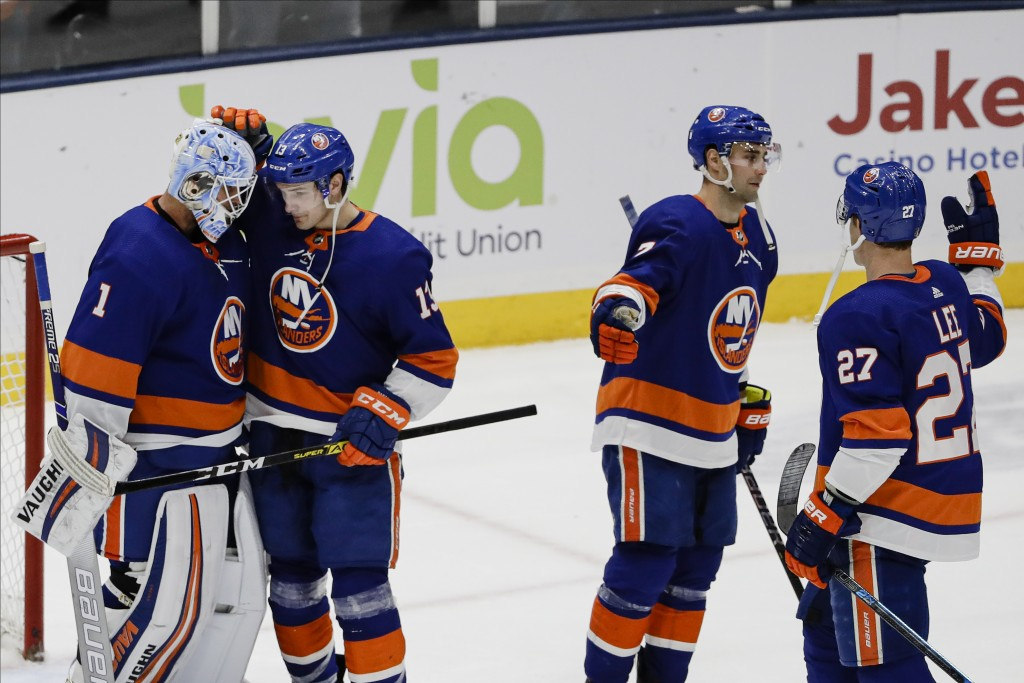 New York Islanders goaltender Thomas Greiss (1) celebrates with teammates Mathew Barzal (13), Jordan Eberle (7) and Anders Lee (27) during the third p...