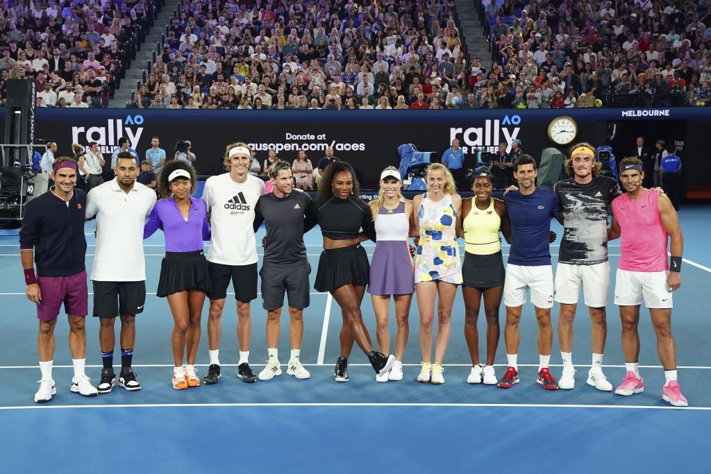 In this Jan. 15, 2020, photo, from left, Roger Federer of Switzerland, Nick Kyrgios of Australia, Naomi Osaka of Japan, Alexander Zverev, Dominic Thie...