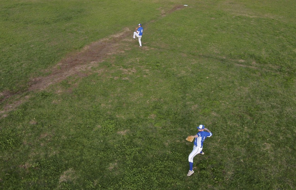 In this Tuesday, Jan. 14, 2020 photo, players for Israel's national baseball team practice in Tel Aviv, Israel. Team Israel's improbable run to the To...