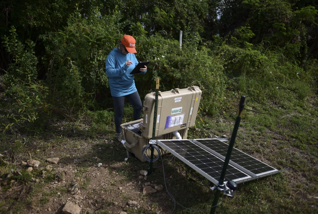 Alena L. Leeds, a scientist from the United States Geological Survey, operates earthquake monitoring and recording equipment amid aftershocks across t...