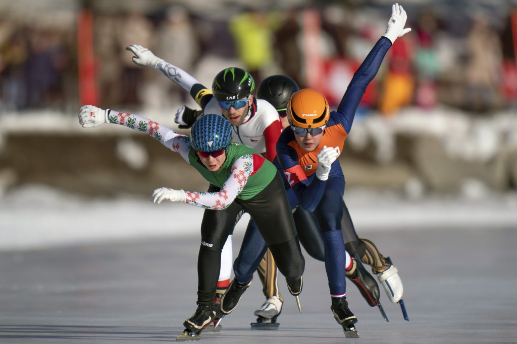 In this photo provided by the IOC, Varvara Bandaryna, of Belarus, front, Myrthe De Boer, of Netherlands, right, and Lukas Stekly, of the Czech Republi...