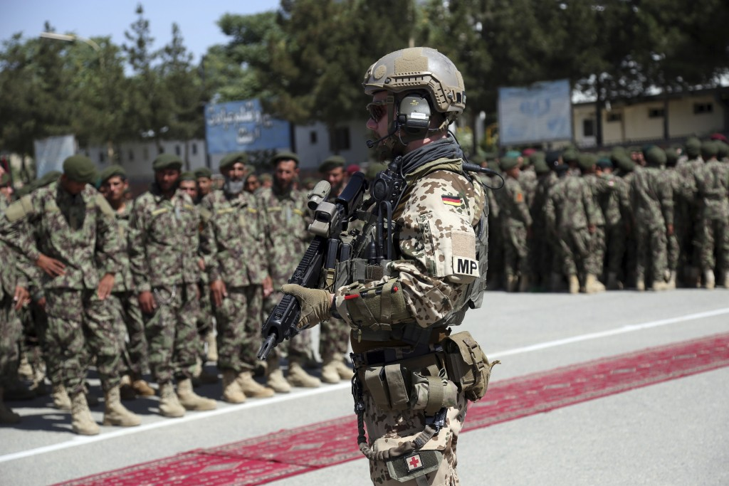 FILE- In this Wednesday, July 10, 2019 file photo, a German soldier with NATO forces stands guard during the graduation ceremony of newly Afghan Natio...
