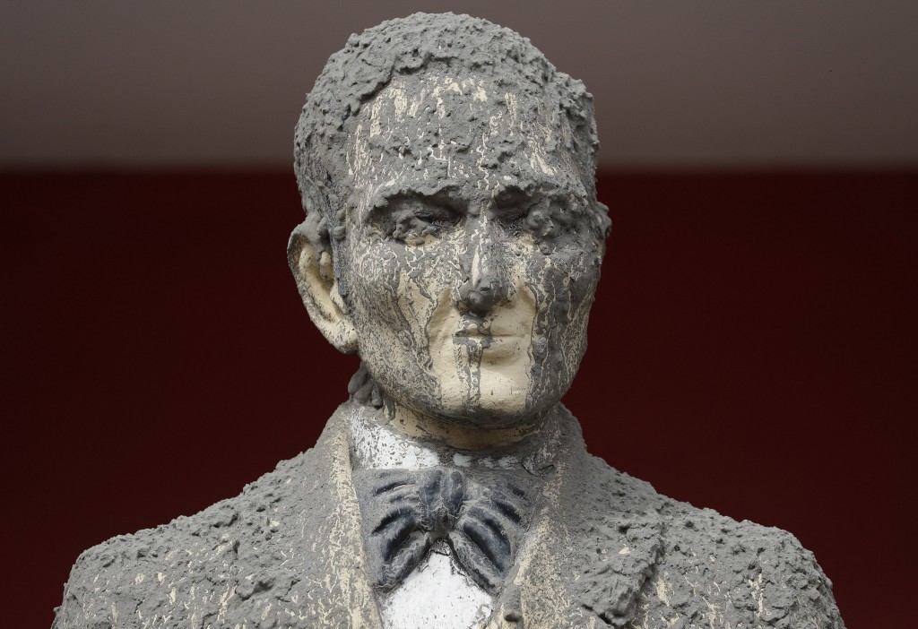 In this Wednesday, Jan. 15, 2020, photo, A statue of Philippine national hero Jose Rizal is covered in volcanic ash in Talisay, Batangas province, sou...