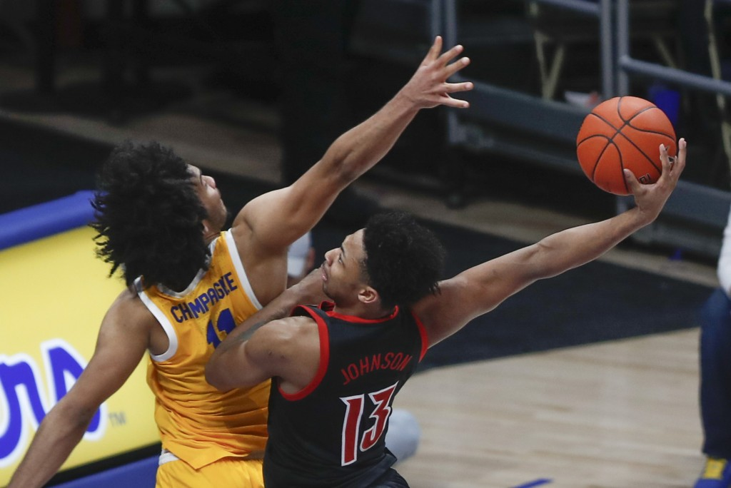Louisville's David Johnson (13) goes to the basket at Pittsburgh's Justin Champagnie defends during the second half of an NCAA college basketball game...