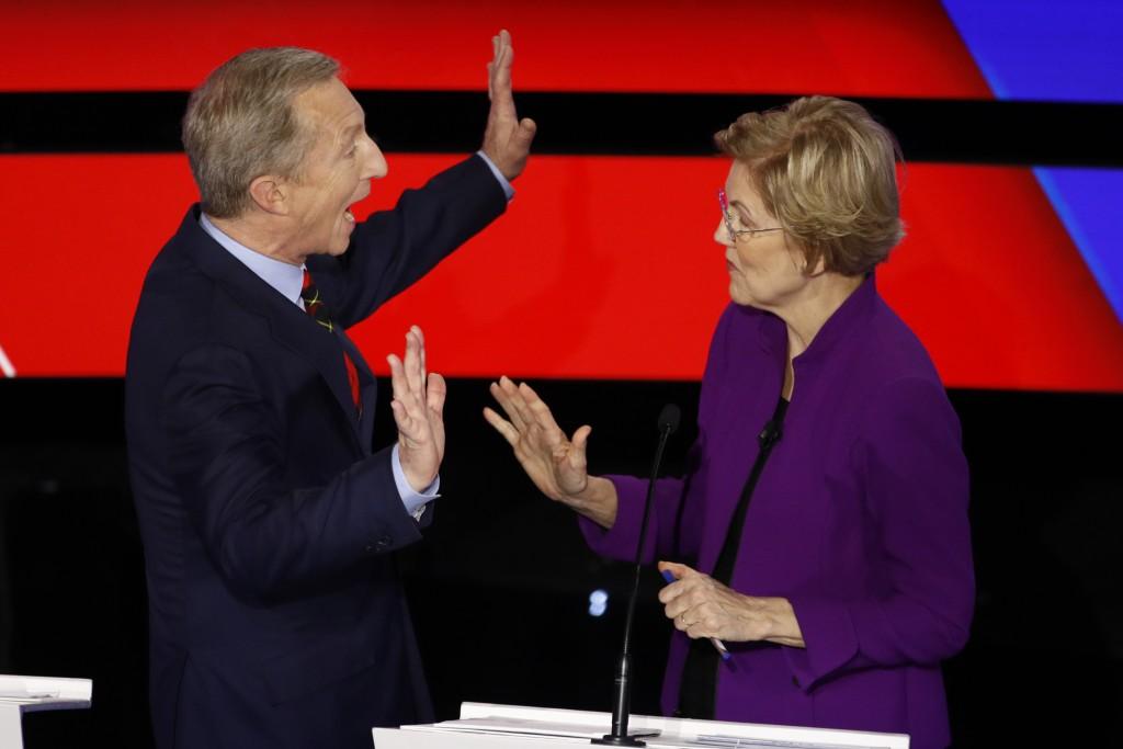 Democratic presidential candidates businessman Tom Steyer, left and Sen. Elizabeth Warren, D-Mass., talk during a break Tuesday, Jan. 14, 2020, during...