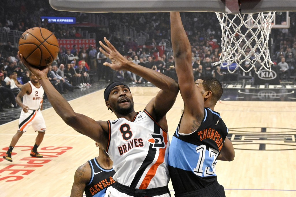 Los Angeles Clippers forward Maurice Harkless, left, shoots as Cleveland Cavaliers center Tristan Thompson defends during the first half of an NBA bas...