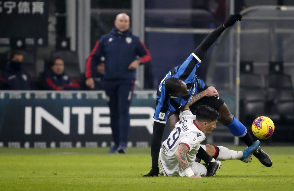 Inter Milan's Romelu Lukaku, top, duels for the ball with Cagliari's Fabio Pisacane during an Italian Cup soccer match between Inter Milan and Cagliar...