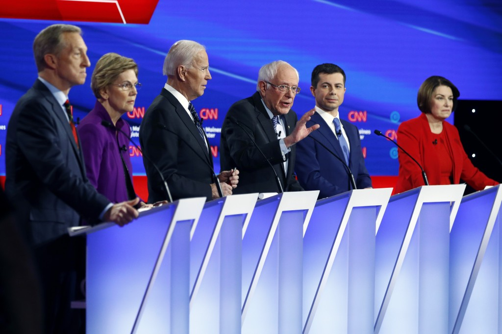 Democratic presidential candidate Sen. Bernie Sanders, I-Vt.,, center, speaks as fellow candidates businessman Tom Steyer, from left, Sen. Elizabeth W...