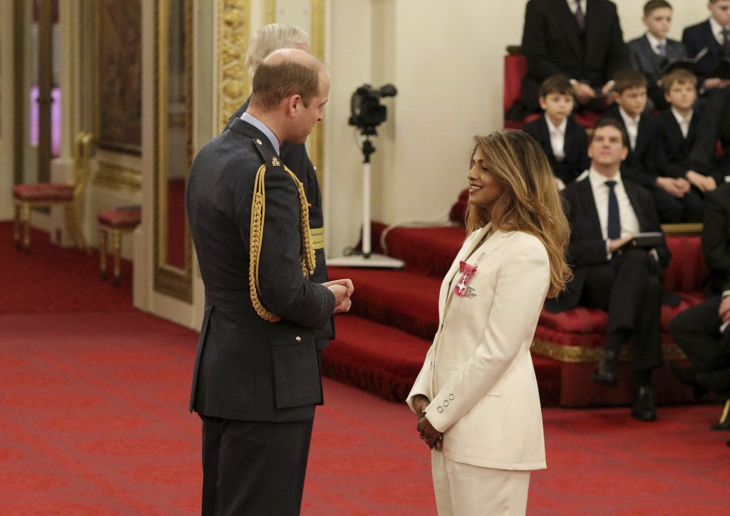 Rapper and singer MIA, real name Mathangi Arulpragasam, is made an MBE by Prince William Duke of Cambridge, left, at Buckingham Palace, in London, Tue...