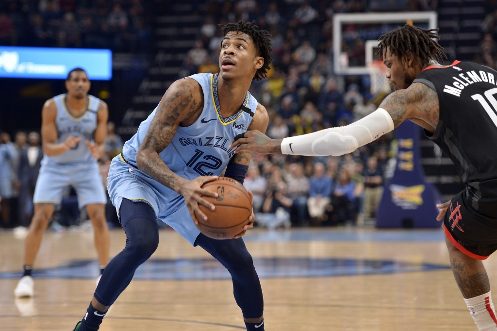 Memphis Grizzlies guard Ja Morant (12) is defended by Houston Rockets guard Ben McLemore (16) in the second half of an NBA basketball game Tuesday, Ja...