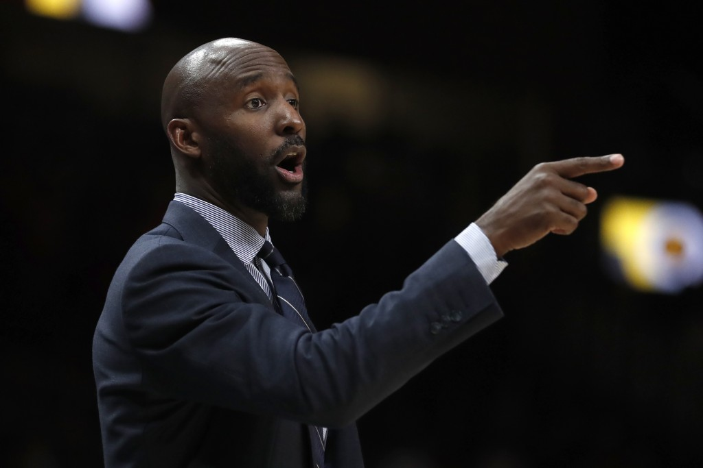 Atlanta Hawks head coach Lloyd Pierce directs his players on the court in the first half of an NBA basketball game against the Phoenix Suns Tuesday, J...