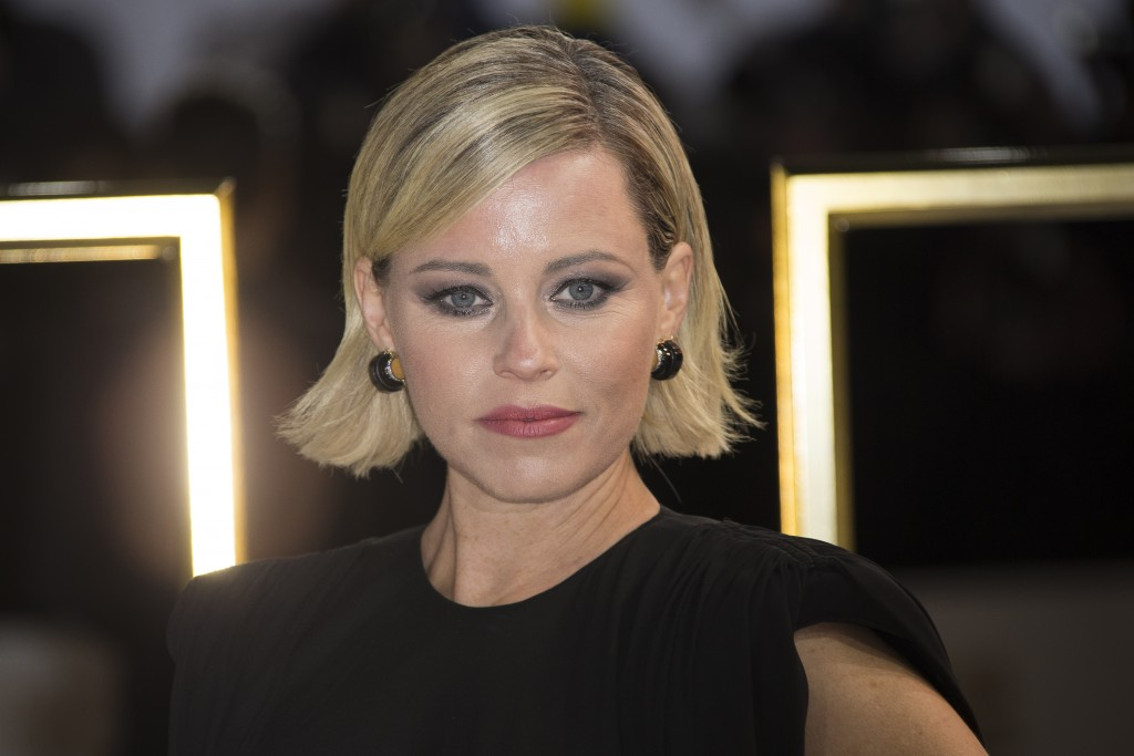 FILE - In this Nov. 20, 2019 file photo, Elizabeth Banks poses for photographers upon arrival at the UK premiere of 'Charlie's Angels', at a central L...