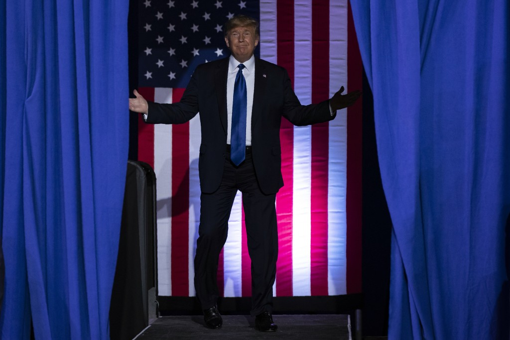 President Donald Trump arrives at UW-Milwaukee Panther Arena to speak at a campaign rally, Tuesday, Jan. 14, 2020, in Milwaukee. (AP Photo/ Evan Vucci...