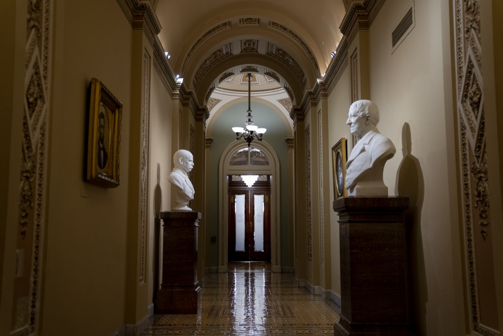 The entrance to the Senate cloakroom at the Capitol is seen in Washington, early Wednesday, Jan. 15, 2020, as the House is set to vote to send the art...
