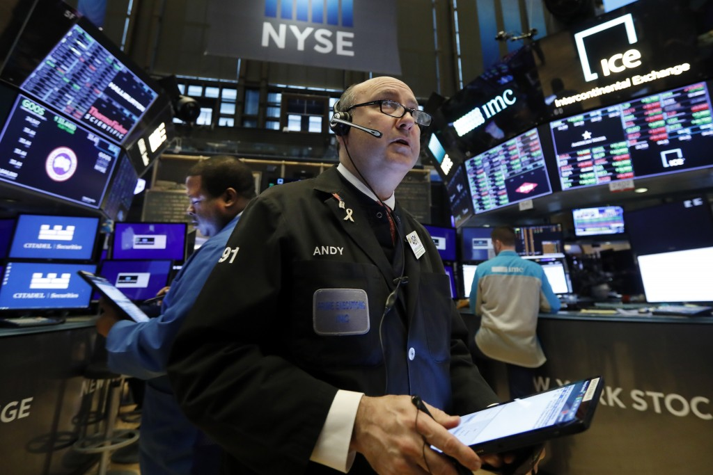 FILE - In this Jan. 10, 2020, file photo trader Andrew Silverman works on the floor of the New York Stock Exchange. The U.S. stock market opens at 9:3...