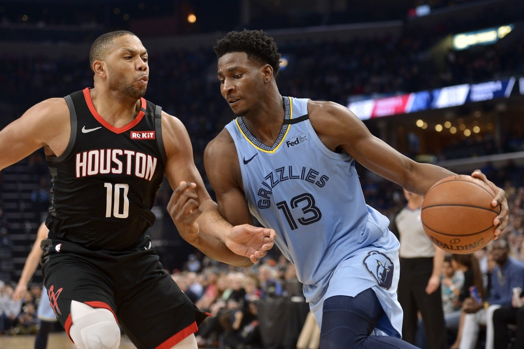 Memphis Grizzlies forward Jaren Jackson Jr. (13) drives against Houston Rockets guard Eric Gordon (10) during the second half of an NBA basketball gam...
