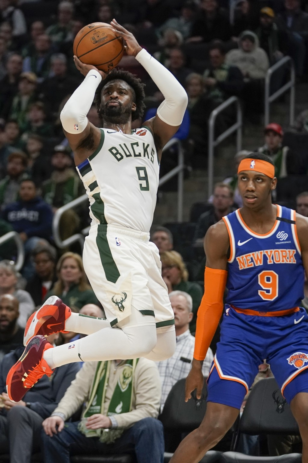 Milwaukee Bucks' Wesley Matthews shoots over New York Knicks' RJ Barrett during the second half of an NBA basketball game Tuesday, Jan. 14, 2020, in M...