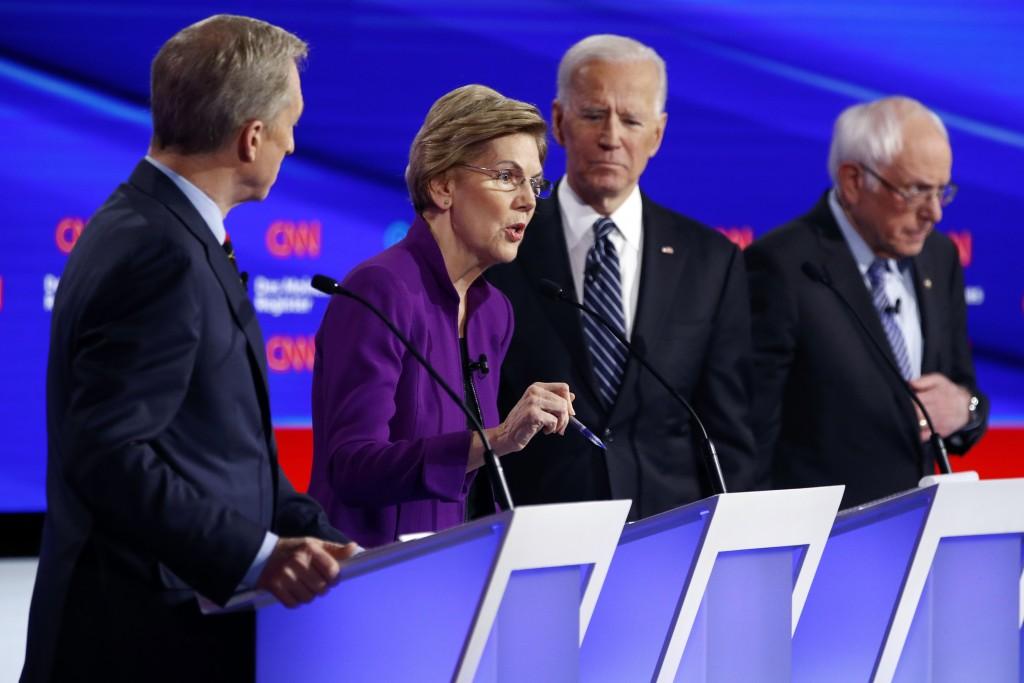 Democratic presidential candidate Sen. Elizabeth Warren, D-Mass., second from left, speaks as fellow candidates businessman Tom Steyer, left, former V...