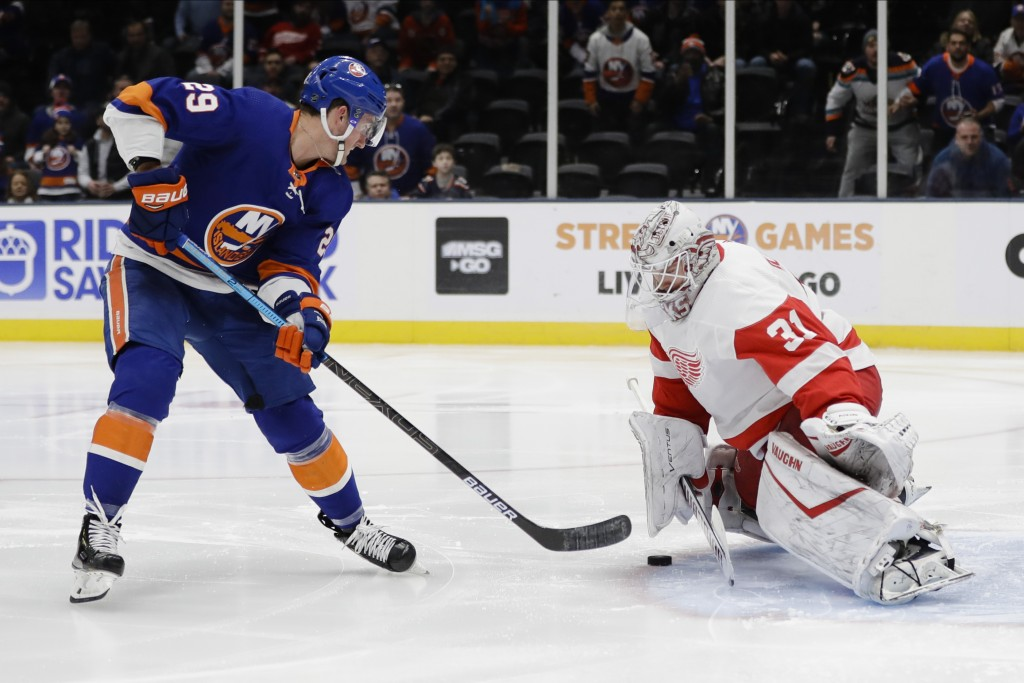 New York Islanders' Brock Nelson (29) shoots the puck past Detroit Red Wings' goal tender Calvin Pickard (31) during the second period of an NHL hocke...