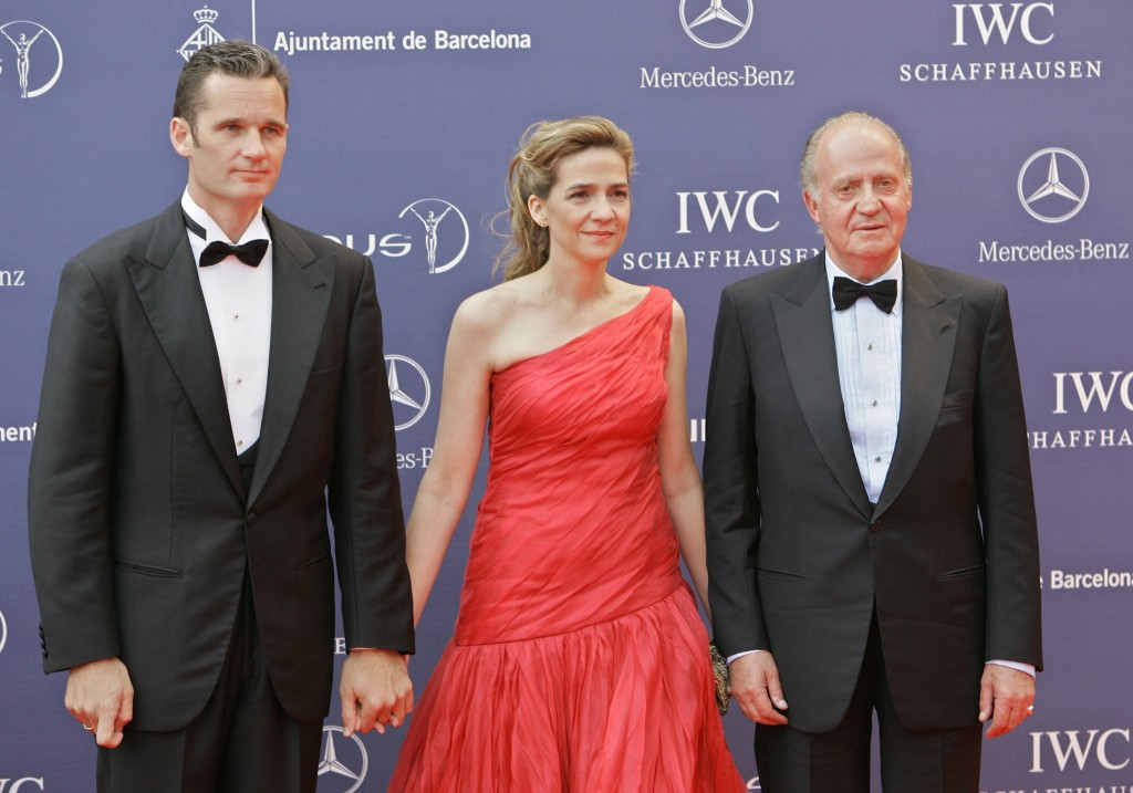 FILE - In this May 22, 2006 file photo, Spain's King Juan Carlos, right, arrives with his daughter, Princess Cristina and her husband Inaki Urdangarin...