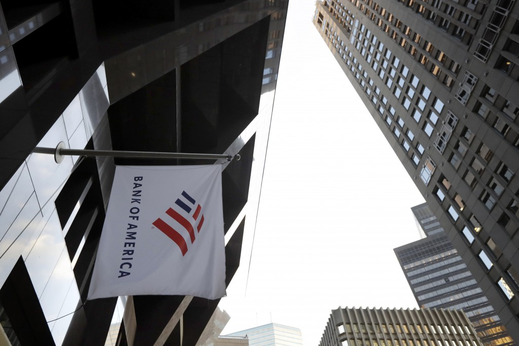 FILE - In this Oct. 14, 2019, file photo photo a Bank of America flag waves in front of the Bank of America Financial Center building, in Boston. Bank...