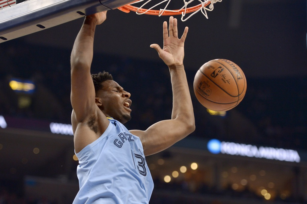 Memphis Grizzlies forward Jaren Jackson Jr. (13) dunks during the second half of the team's NBA basketball game against the Houston Rockets on Tuesday...