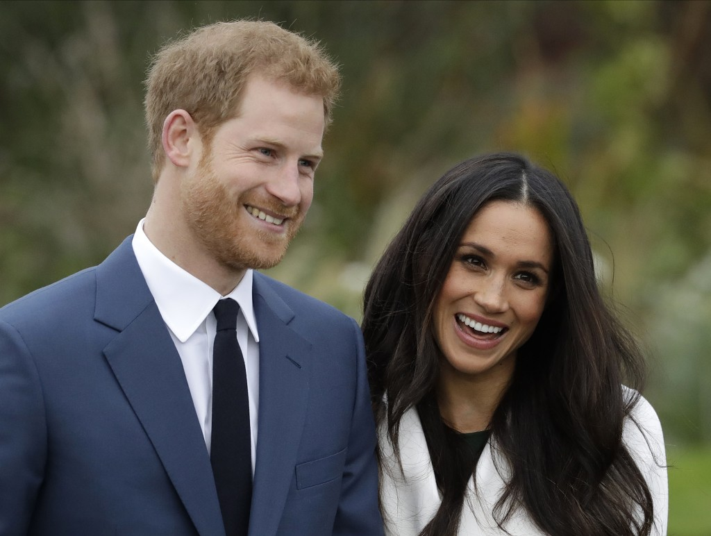 FILE - In this Monday Nov. 27, 2017 file photo, Britain's Prince Harry and his fiancee Meghan Markle pose for photographers during a photocall in the ...