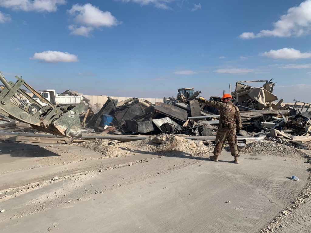 U.S. soldiers clear rubble from a site of Iranian bombing at Ain al-Asad air base in Anbar, Iraq, Monday, Jan. 13, 2020. Ain al-Asad air base was stru...