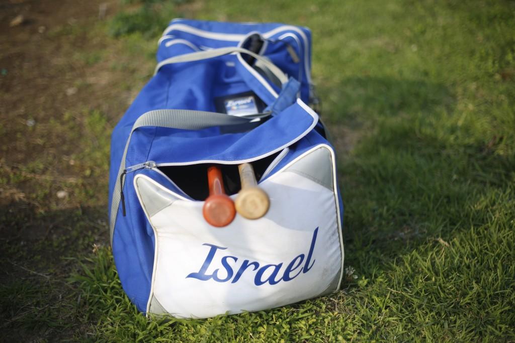 In this Tuesday, Jan. 14, 2020 photo, baseball equipment lies on the ground during an Israeli national baseball team practice, in Tel Aviv, Israel. Te...