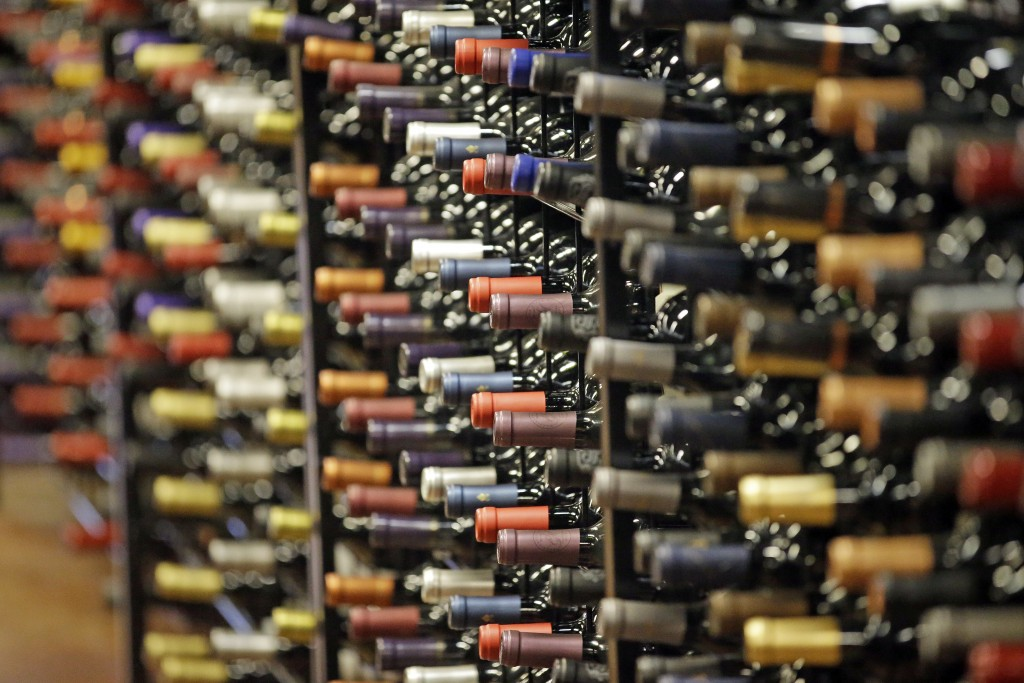 FILE - In this June 16, 2016, file photo, bottles of wine are displayed during a tour of a state liquor store, in Salt Lake City. According to federal...