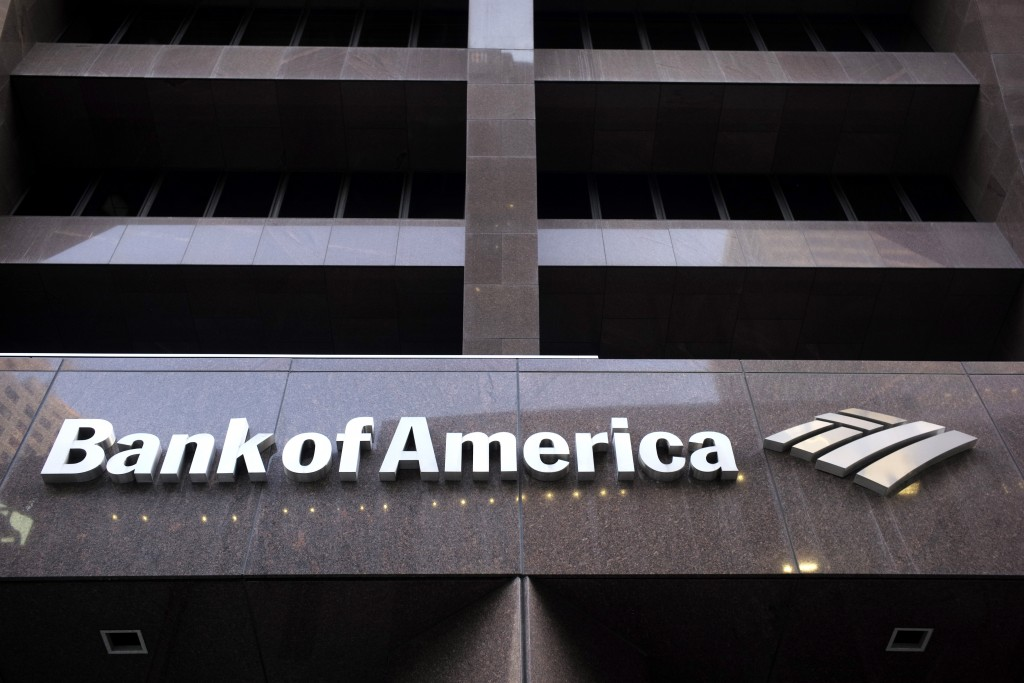 FILE - In this Oct. 14, 2019, file photo a Bank of America logo is attached to the exterior of the Bank of America Financial Center building in Boston...