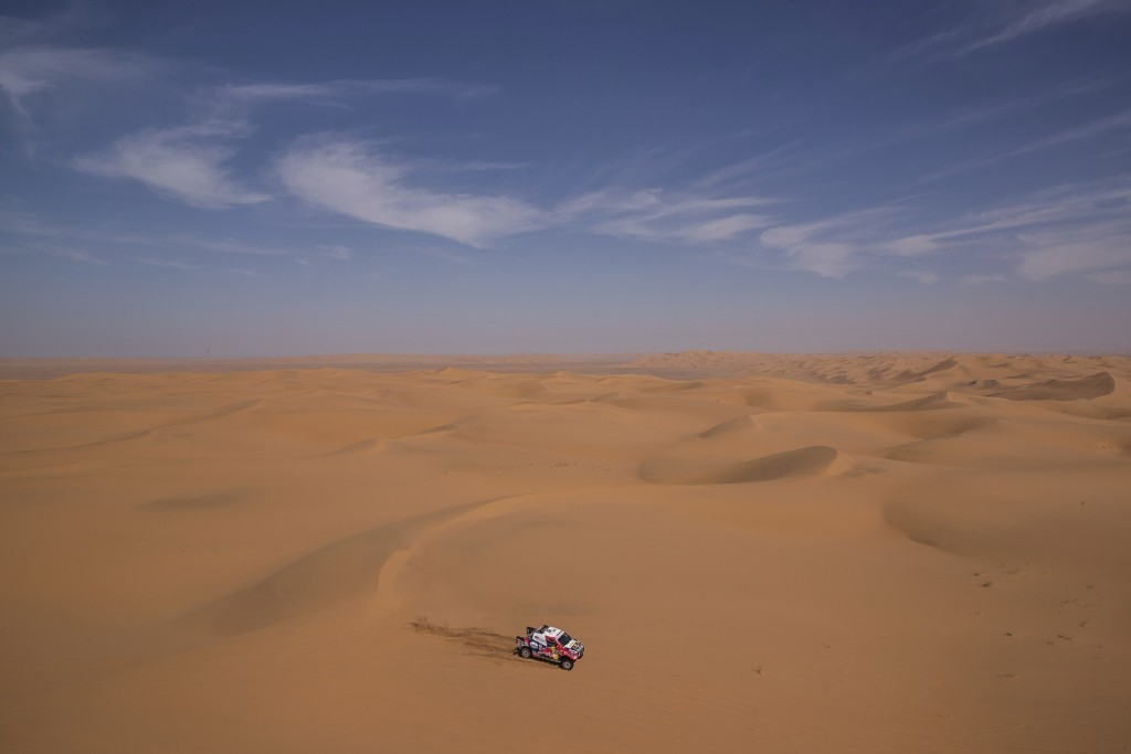 In this Sunday, Jan. 12, 2020 photo, driver Giniel De Villers, of South Africa, and co-driver Alex Haro, of Spain, race their Toyota during stage seve...