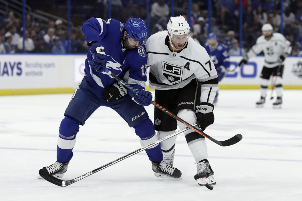 Los Angeles Kings center Jeff Carter (77) knocks the puck away from Tampa Bay Lightning left wing Alex Killorn (17) during the first period of an NHL ...