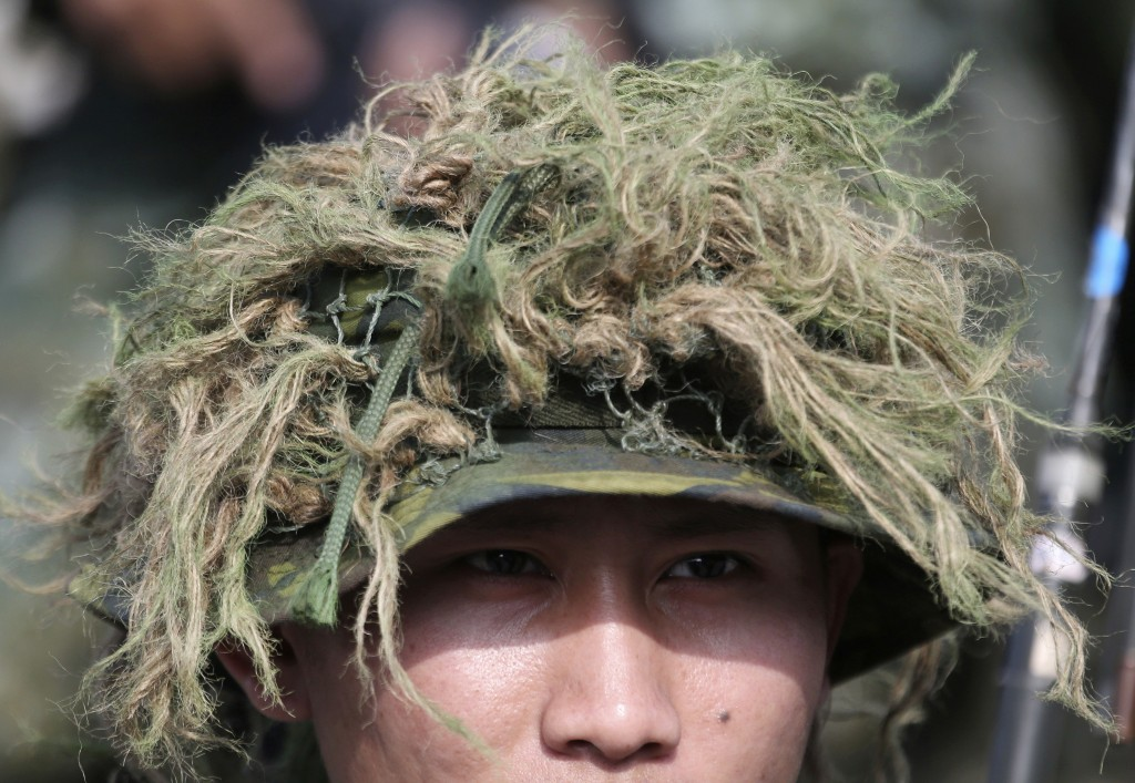 A sniper wears camouflage during a military exercise in Kaohsiung, southern Taiwan, Wednesday, Jan. 15, 2020. Taiwan military started a two-day joint ...