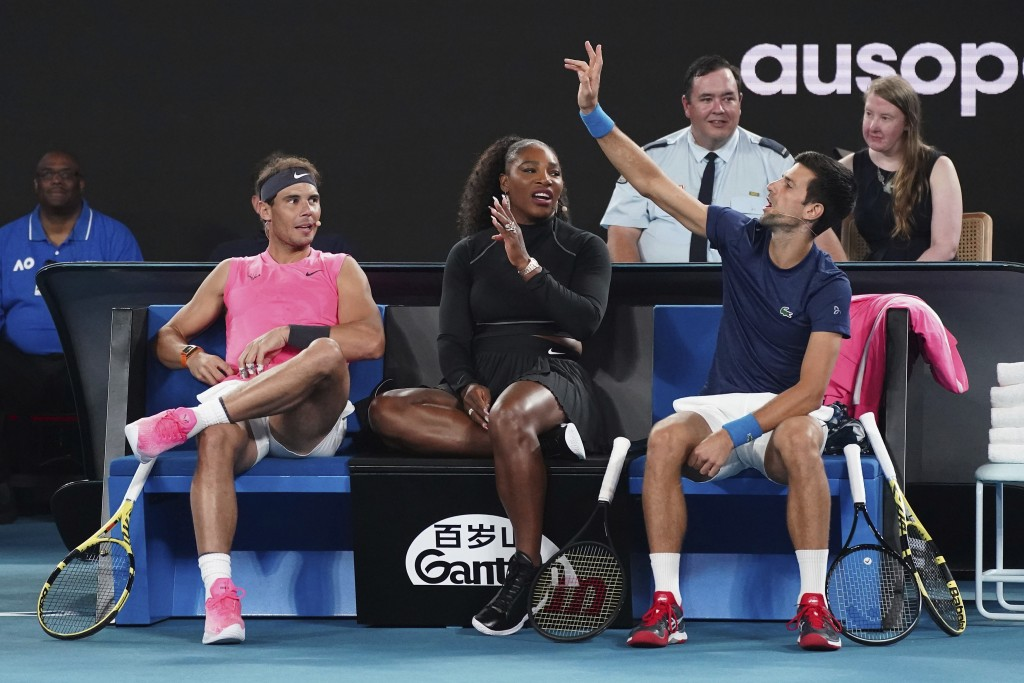 From left, Rafael Nadal of Spain, Serena Williams of the United States and Novak Djokovic of Serbia participate in the Rally For Relief at Rod Laver A...