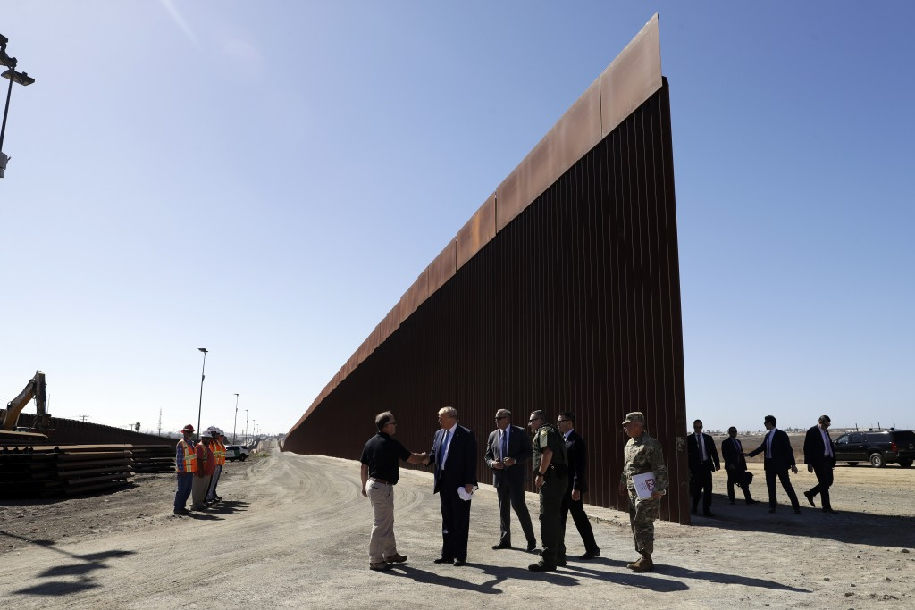 FILE - In this Sept. 18, 2019, file photo, President Donald Trump tours a section of the southern border wall in Otay Mesa, Calif. The Trump administr...