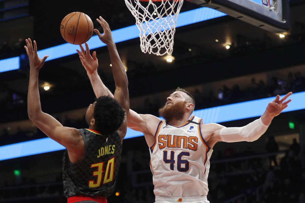 Phoenix Suns center Aron Baynes (46) battles Atlanta Hawks center Damian Jones (30) for a rebound in the first half of an NBA basketball game Tuesday,...