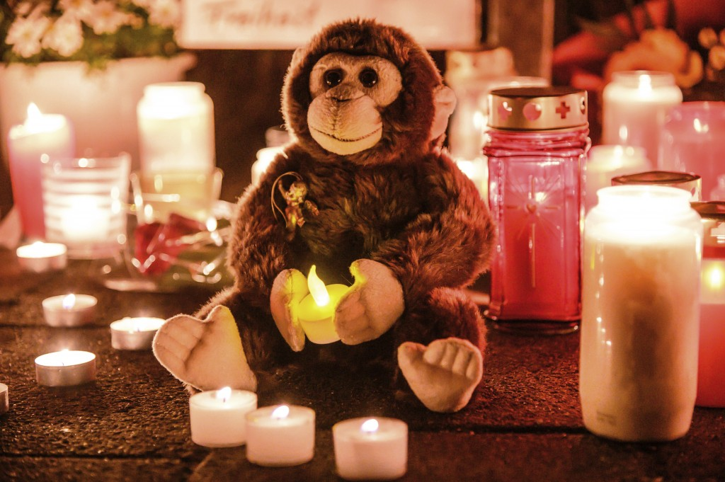 This Wednesday, Jan. 1, 2020, file photo, a toy ape is placed between candles at the entrance of the Zoo in Krefeld, Germany. Authorities said rescuer...