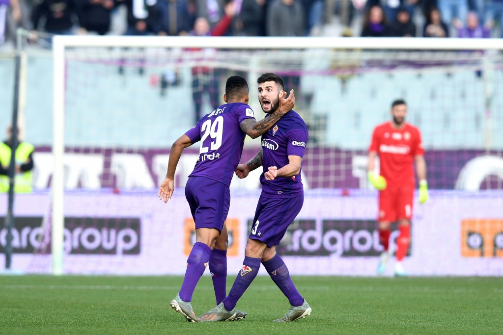 Fiorentina's Patrick Cutrone, right, celebrates after scoring his side's first goal during an Italian Cup eightfinal soccer match, between Fiorentina ...