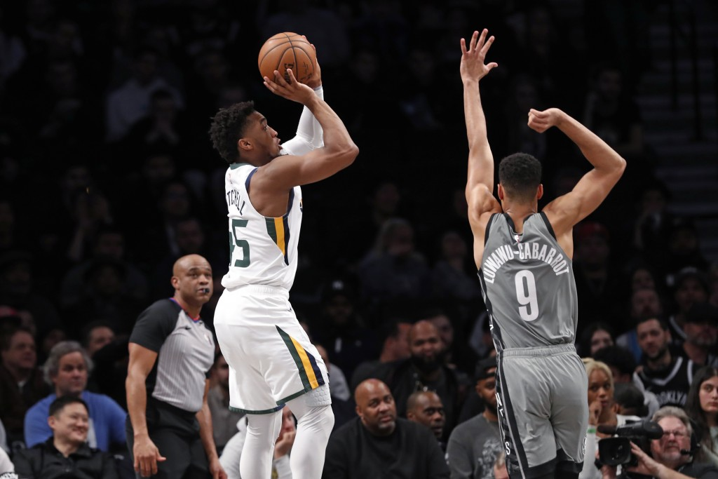 Utah Jazz guard Donovan Mitchell (45) shoots with Brooklyn Nets guard Timothe Luwawu-Cabarrot (9) defending during the second quarter of an NBA basket...