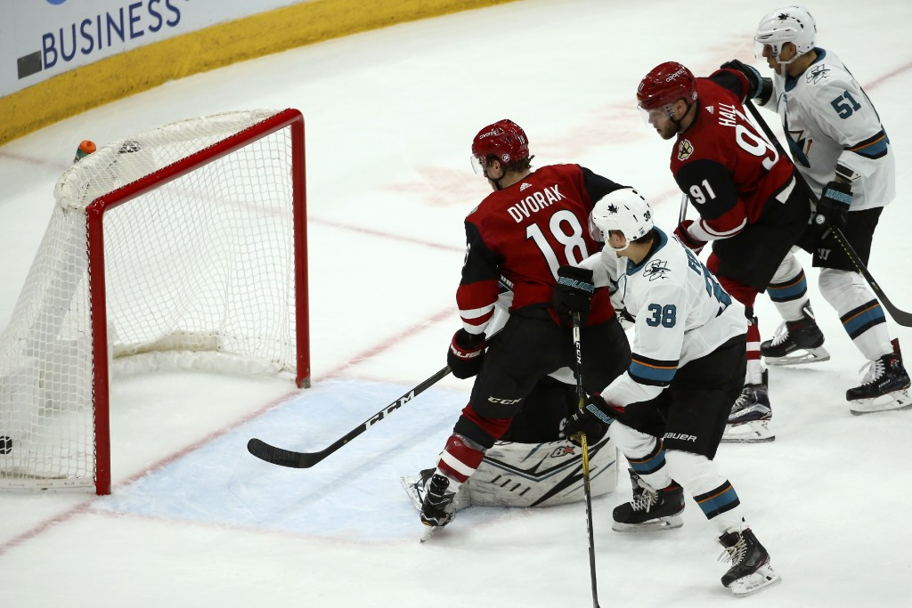 Arizona Coyotes left wing Taylor Hall (91) scores a goal as Coyotes center Christian Dvorak (18), San Jose Sharks defenseman Mario Ferraro (38) and Sh...