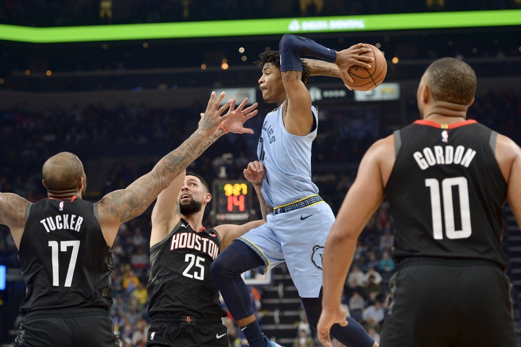 Memphis Grizzlies guard Ja Morant looks to pass the ball over Houston Rockets forward PJ Tucker (17) and guard Austin Rivers (25) during the second ha...