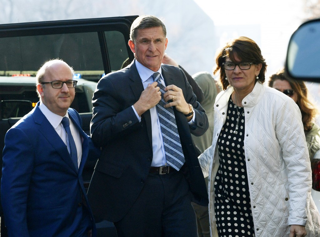 FILE - In this Dec. 1, 2017, file photo, Michael Flynn, center, arrives at federal court in Washington.  (AP Photo/Susan Walsh, File)