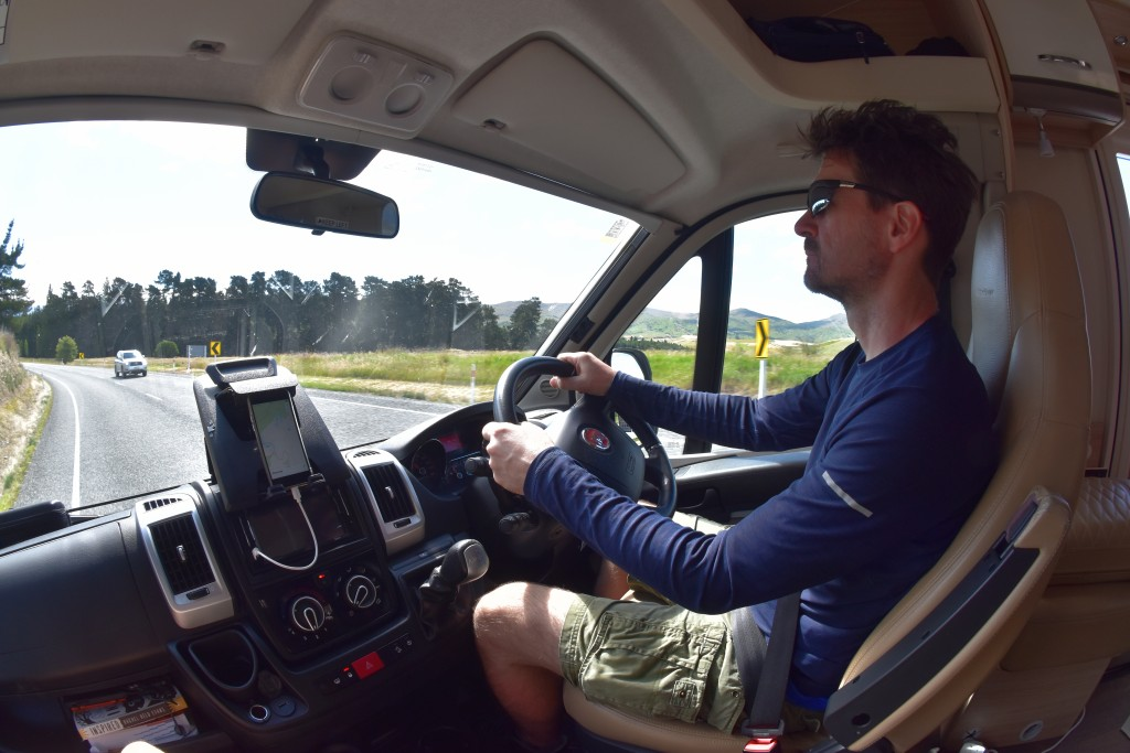 This Dec. 22, 2019, photo taken with a fisheye lens shows Malcolm Foster driving a rented camper van on the South Island of New Zealand. Touring in a ...